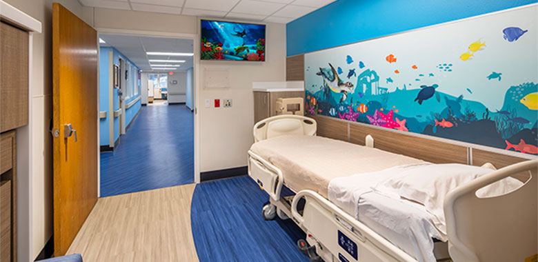 RS&H refreshes Arnold Palmer Hospital Children Patient Rooms with eye drawing detail.