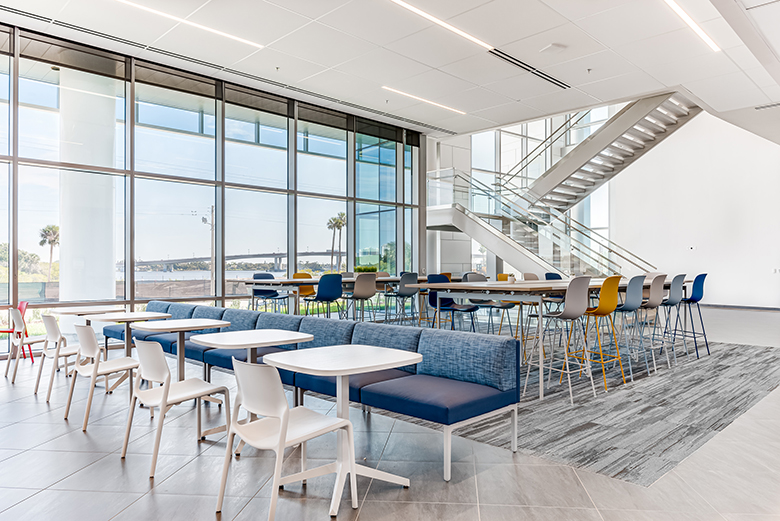 Photo of Brown & Brown break room with modern, comfortable seating and a floor-to-ceiling view of the water.