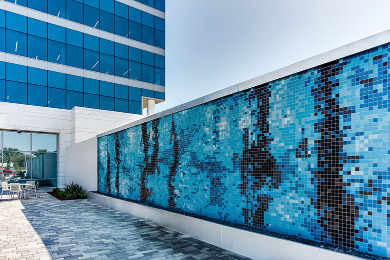 Photo of mosaic art wall on Brown and Brown's new rooftop area.