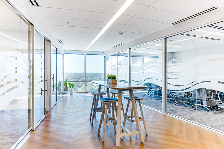 Photo of glass-walled meeting areas to maximize the view in Brown and Brown's new headquarters.