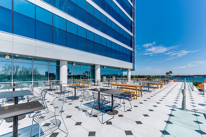 Open-air deck at Brown and Brown headquarters with stylish, modern seating and an unobstructed view of the Halifax River.