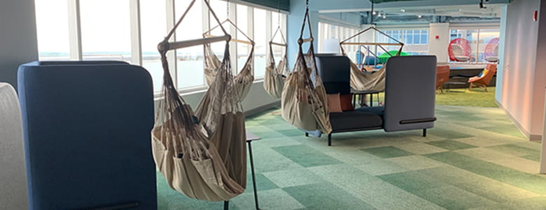 The Vystar tower hammock swing adds a bold style to a credit union financial building..
