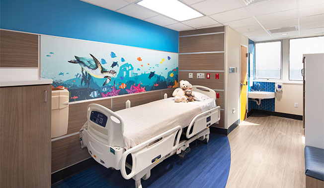 Bright, colorful children's patient room refreshed by RS&H for Arnold Palmer Hospital.
