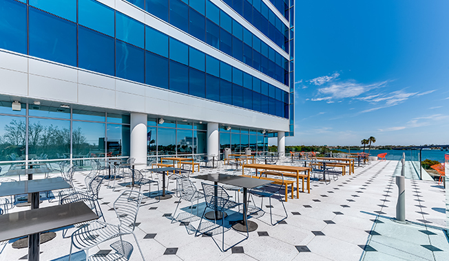 Photo of deck with water view designed by RS&H architects for Brown and Brown's new headquarters in Daytona Beach, Florida.
