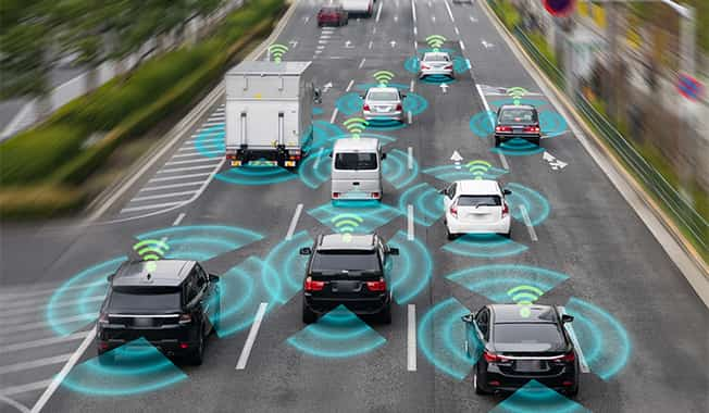 Broadband connected vehicles transmitting data in highway traffic depict importance of transportation infrastructure.