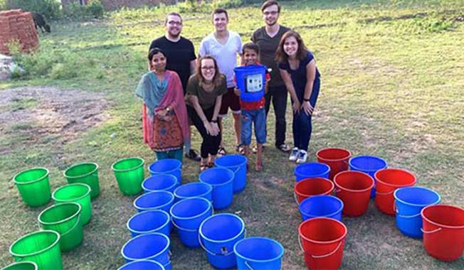 Photo of a team giving back to global communities in a Non-Profit organization.
